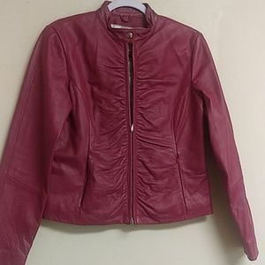 Really cute. Ladies pink leather jacket Used.